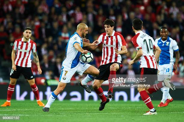 Mikel San Jose of Athletic Club competes for the ball with Nourredine Amrabat of Club Deportivo Leganes during the La Liga match between Athletic...