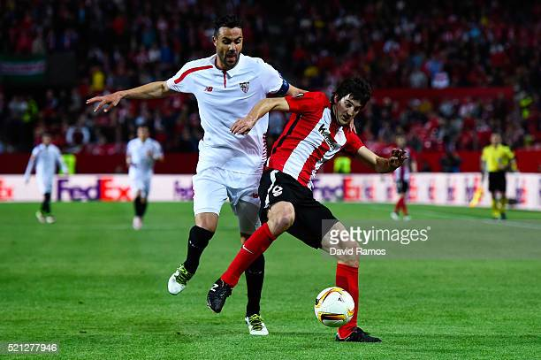 Mikel San Jose of Athletic Club competes for the ball with Vicente Iborra of Sevilla FC during the UEFA Europa League quarter final second leg match...