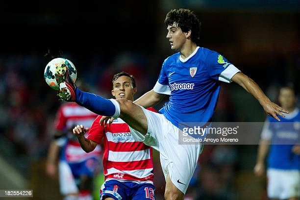 Mikel San Jose of Athletic Club controls the ball in front of Diego Buonanotte of Granada CF during the La Liga match between Granada CF and Athletic...