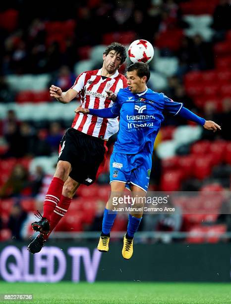 Mikel San Jose of Athletic Club duels for the ball with Fernando Quesada of SD Formentera during the Copa del Rey Round of 32 Second Leg match...