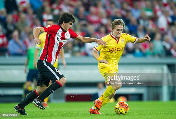 Mikel San Jose of Athletic Club duels for the ball with Halilovic of Real Sporting de Gijon during the La Liga match between Athletic Club and Real...