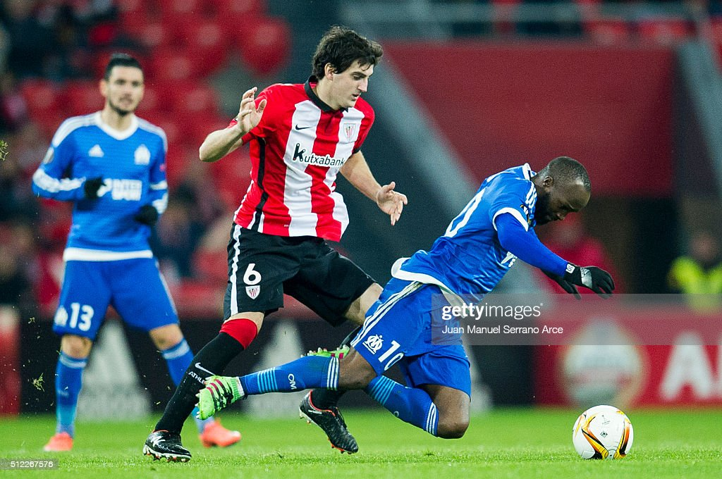 Mikel San Jose of Athletic Club duels for the ball with Lassana Diarra of Marseille during the UEFA Europa League Round of 32: Second Leg match between Athletic Club and Marseille at San Mames Stadium on February 25, 2016 in Bilbao, Spain.