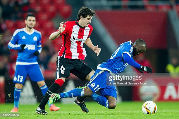 Mikel San Jose of Athletic Club duels for the ball with Lassana Diarra of Marseille during the UEFA Europa League Round of 32 Second Leg match...