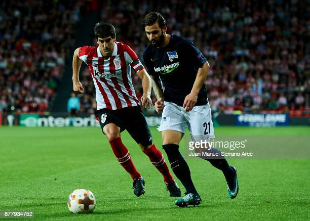 Mikel San Jose of Athletic Club duels for the ball with Marvin Plattenhardt of Hertha BSC during the UEFA Europa League group J match between...
