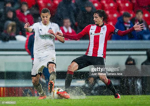 Mikel San Jose of Athletic Club duels for the ball with Rodrigo Moreno of Valencia CF during the UEFA Europa League Round of 16 First Leg match...