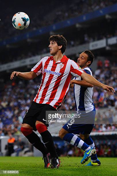 Mikel San Jose of Athletic Club duels for the ball with Sergio Garcia of RCD Espanyol during the La Liga match between RCD Espanyol and Athletic Club...