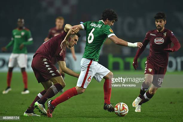 Mikel San Jose of Athletic Club is challenged by Nikola Maksimovic of Torino FC during the UEFA Europa League Round of 32 match between Torino FC and...