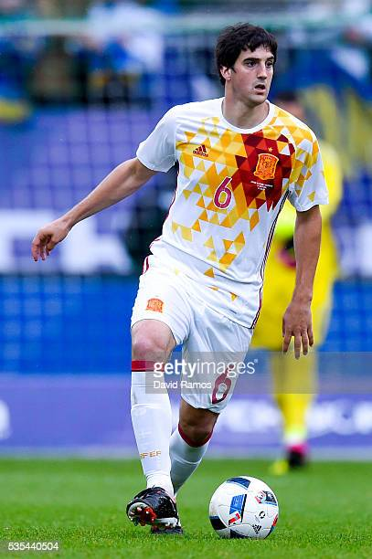Mikel San Jose of Spain runs with the ball during an international friendly match between Spain and Bosnia at the AFG Arena on May 29, 2016 in St...
