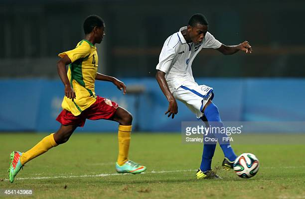 Mikel Santos#9 of Honduras is challenged by Brian Taut of Vanuatu during the 2014 FIFA Boys Summer Youth Olympic Football Tournament 5th/6th Place...