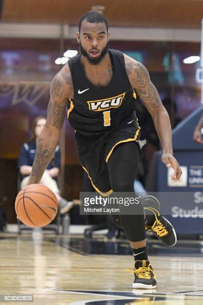 Mike'l Simms of the Virginia Commonwealth Rams dribbles up court during a college basketball game against the George Washington Colonials at the...