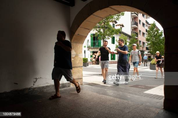 Mikel the cook of the Restaurante Hermandad de Pescadores talks with suppliers as he enters the tunnel under the old guild on July 24 2018 in...