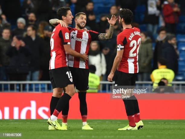 Mikel Vesga Inigo Martinez and Raul Garcia of Athletic Club celebrate at full time following the Liga match between Real Madrid CF and Athletic Club...