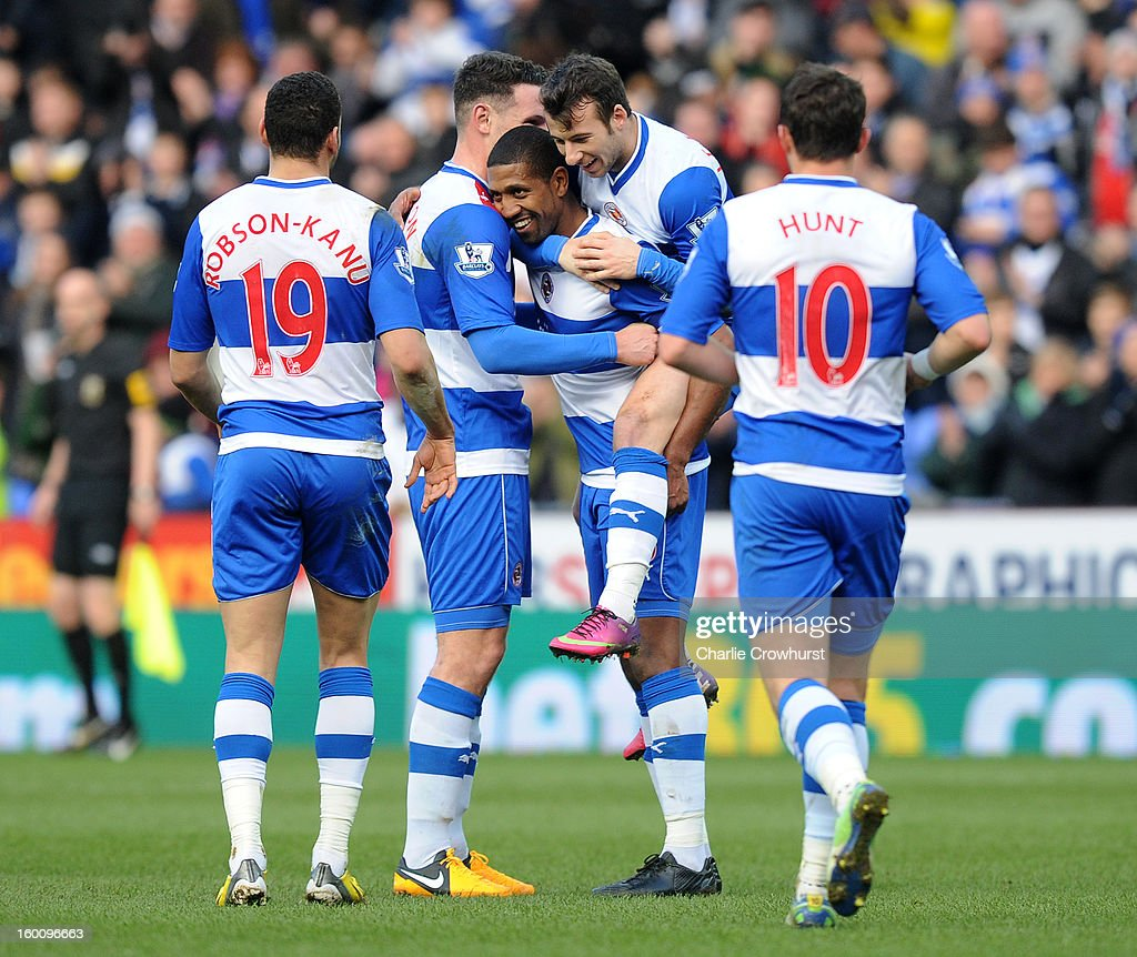 Mikele Leigertwood of Reading celebrates with team mates after scoring the teams second goal during the FA Cup Fourth Round match between Reading and Sheffield United at the Madejski Stadium on January 26, 2013 in London England.