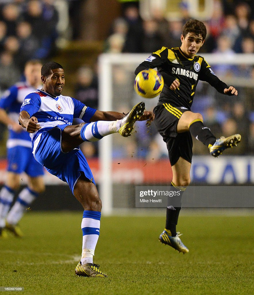 Mikele Leigertwood of Reading is challenged by Oscar of Chelsea during the Barclays Premier League match between Reading and Chelsea at Madejski Stadium on January 30, 2013 in Reading, England.