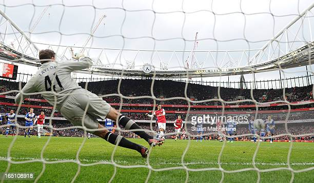 Mikes Arteta send Reading goalkeeper Stuart Taylor the wrong way to score the 4th Arsenal goal from the penalty spot during the Barclays Premier...