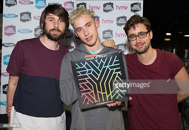 Mikey Goldsworthy Olly Alexander and Emre Turkmen of Years Years sign their debut album 'Communion' at midnight at HMV Oxford Street on July 9 2015...