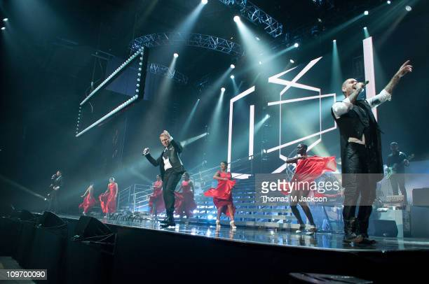 Mikey Graham Keith Duffy Ronan Keating and Shane Lynch of Boyzone perform on stage at Metro Radio Arena on March 1 2011 in Newcastle upon Tyne England