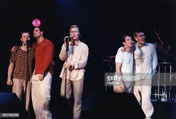 Mikey Graham Keith Duffy Ronan Keating Stephen Gately and Shane Lynch of Boyzone perform on stage at Battersea Power Station on December 13th 1997 in...