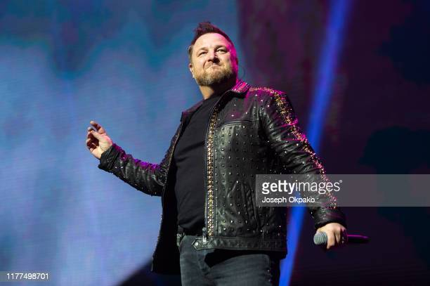 Mikey Graham of Boyzone performs on stage at London Palladium during The Final Five tour on October 21 2019 in London England