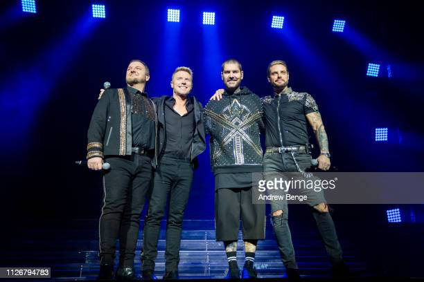ONLY Mikey Graham Ronan Keating Shane Lynch and Keith Duffy of Boyzone perform at First Direct Arena on February 01 2019 in Leeds England