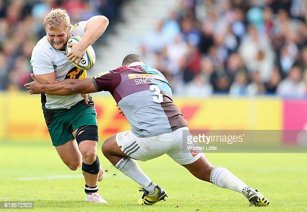 Mikey Haywood of Northampton Saints is tackled by Kyle Sinckler of Harlequins during the Aviva Premiership match between Harlequins and Northampton...