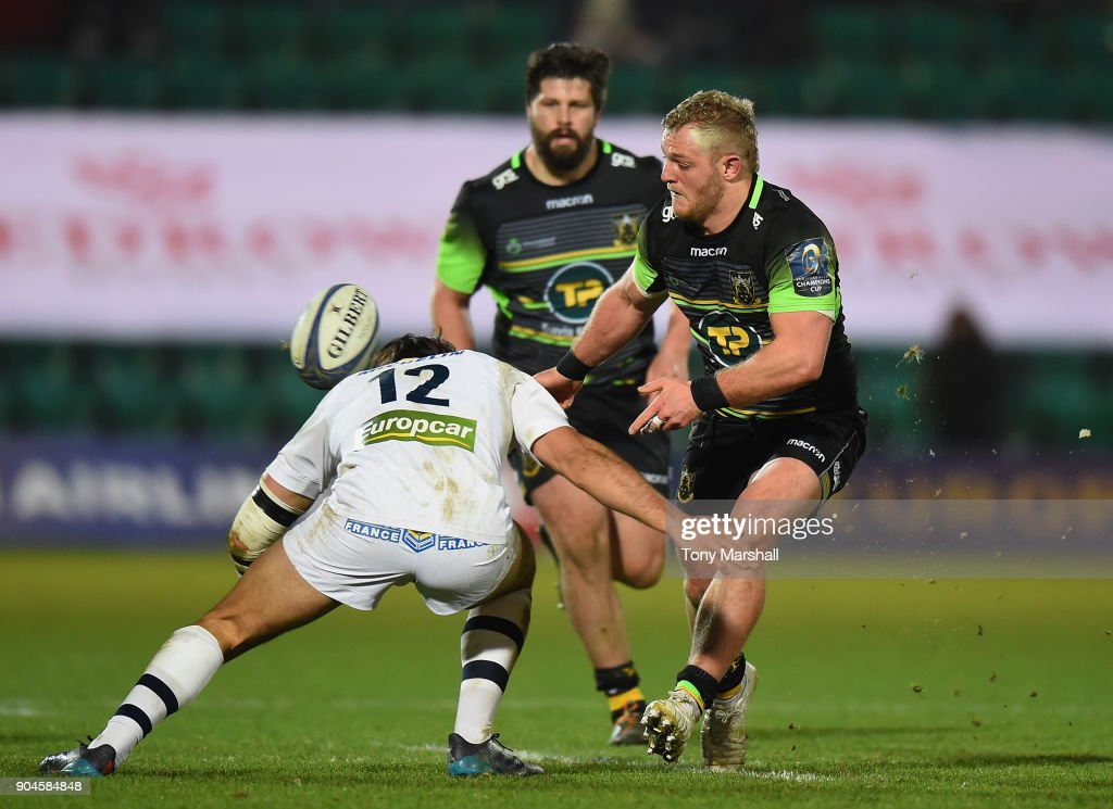 Mikey Haywood of Northampton Saints is tackled by Rémi Lamerat of ASM Clermont Auvergne during the European Rugby Champions Cup match between Northampton Saints and ASM Clermont Auvergne at Franklin's Gardens on January 13, 2018 in Northampton, England.