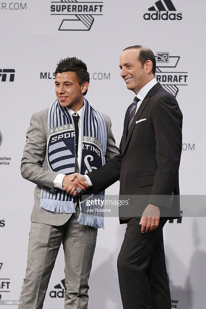 Mikey Lopez of North Carolina shakes hands with commissioner Don Garber after being selected by Sporting Kansas City as the 14th overall pick in the 2013 MLS SuperDraft Presented by Adidas at the Indiana Convention Center on January 17, 2013 in Indianapolis, Indiana.