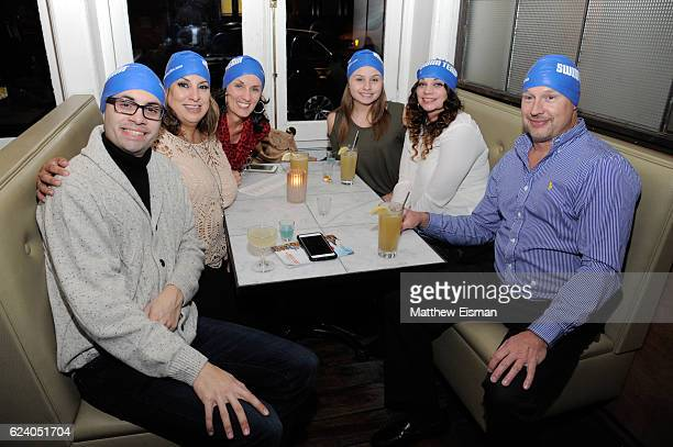 """Mikey McQuay Jr. , Maria McQuay and guests pose together for a photo at the afterparty for the New York premiere of """"Swim Team"""" at DOC NYC on..."""