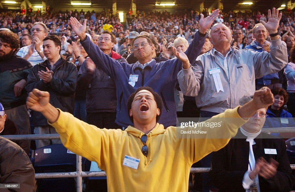 Mikey Morales worships Jesus during the last mission to California for America's best known evangelist, 84-year-old Billy Graham, on May 8, 2003 to San Diego, California. Some 54,000 people attended tonight's service which is expected to total 200,000 over the four-night event as thousands convert to Christianity.