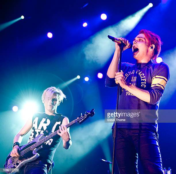 Mikey Way and Gerard Way of My Chemical Romance perform on stage at LG Arena on February 13 2011 in Birmingham England