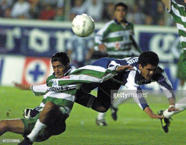 Mikguel Carreon of Santos Laguna fouls Pedro Pineda of Pachuca in the final match of the Mexican Championship May 17 2001 in the Hidalgo Pachuca...