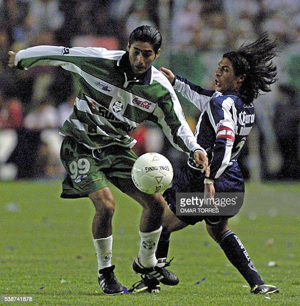 Mikguel Carreon of the Santos team fight for the ball with Alberto Rodriguez of the Pachuca team in the final match of the Mexican Championship May...