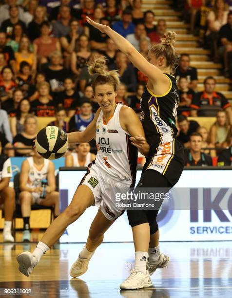 Mikhaela Donnelly of the Townsville Fire looks to get past her opponent during game two of the WNBL Grand Final series between the Melbourne Boomers...