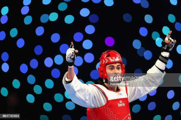 Mikhail Artamonov of Russia celebrates after winning during the 2017 WTF World Taekwondo GrandPrix Series at the Copper Box Arena on October 21 2017...