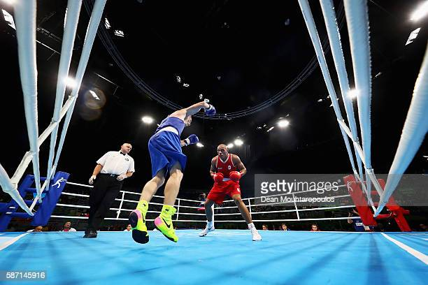 Mikhail Dauhaliavets of Belarus and Valentino Manfredonia of Italy compete in the Men's Light Heavy 81kg preliminary bout on Day 2 of the Rio 2016...