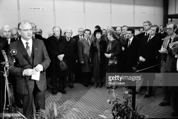 Mikhail Gorbachev, Russian Politburo member and second in line at the Kremlin, watched by his wife Raisa Gorbachev, centre, announces the death of...