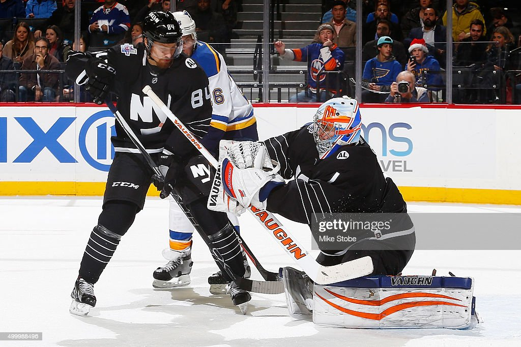 Mikhail Grabovski #84 and Thomas Greiss #1 of the New York Islanders defend their net during the game against the St. Louis Blues at the Barclays Center on December 4, 2015 in Brooklyn borough of New York City. The Islanders defeated the Blues 2-1