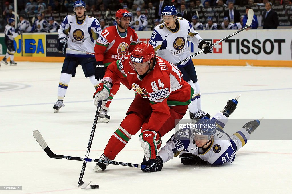 Mikhail Grabovski (L) of Belarus and Evgeni Fadeyev (R) of Kazakhstan battle for the puck during the IIHF World Championship group A match between Slovakia and Russia at Lanxess Arena on May 9, 2010 in Cologne, Germany.