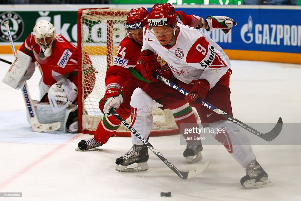 Mikhail Grabovski of Belarus challenges Kasper Degn of Denmark during the IIHF World Championship qualification round match between Belarus and Denmark at Lanxess Arena on May 17, 2010 in Cologne, Germany.