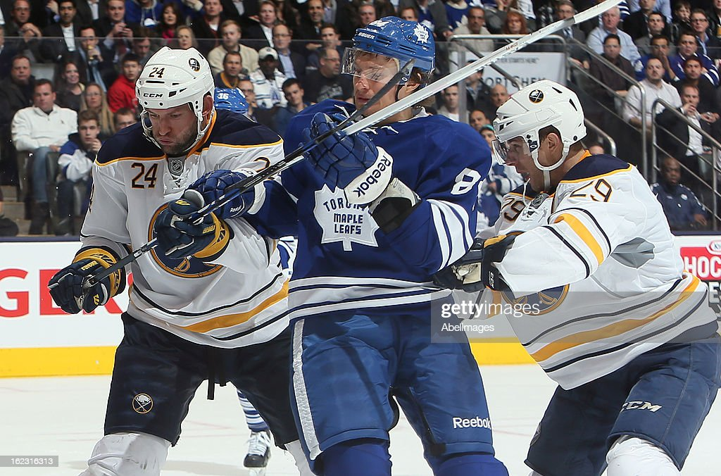 Mikhail Grabovski #84 of the Toronto Maple Leafs gets roughed up by Jason Pominville #29 and Robyn Regehr #24 of the Buffalo Sabres during NHL action at the Air Canada Centre February 21, 2013 in Toronto, Ontario, Canada.