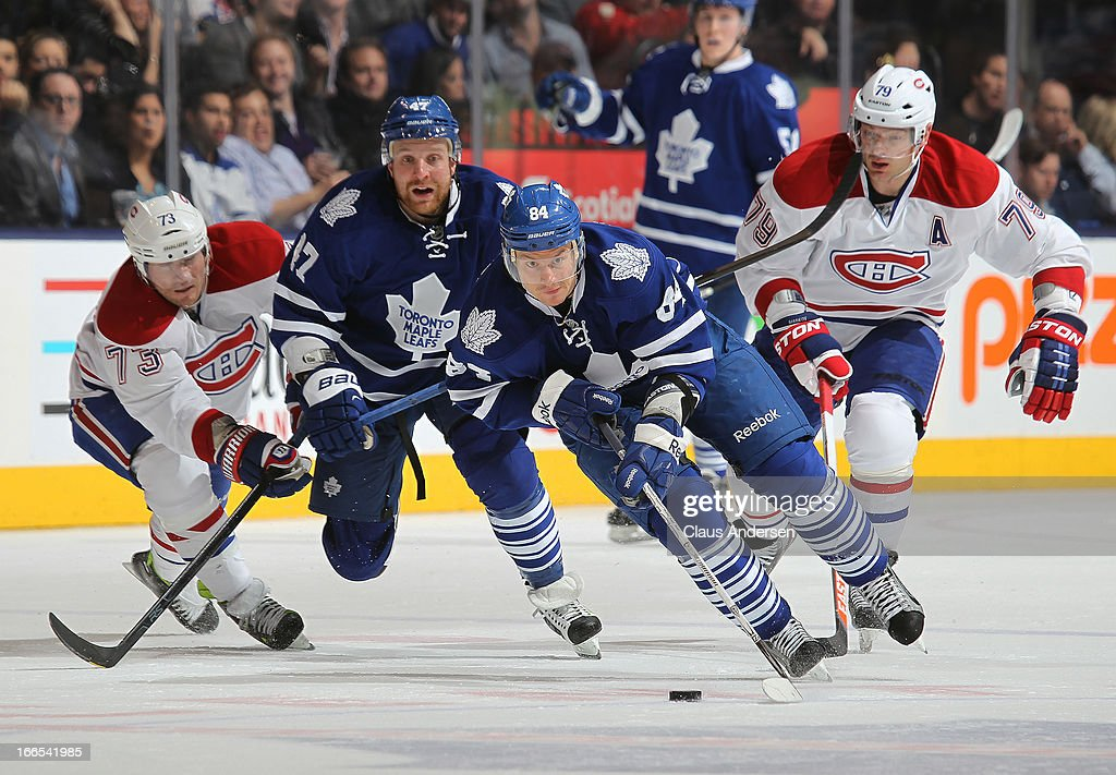 Mikhail Grabovski #84 of the Toronto Maple Leafs heads up ice with the puck in a game against the Montreal Canadiens on April 13, 2013 at the Air Canada Centre in Toronto, Ontario, Canada. The Leafs defeated the Canadiens 5-1.