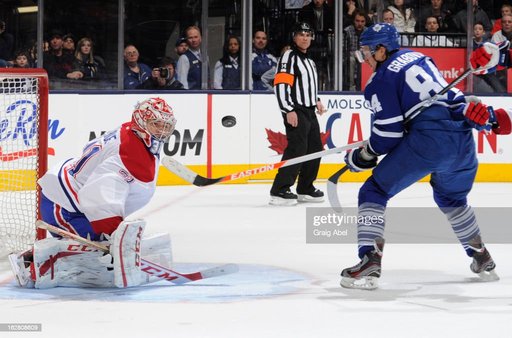 Mikhail Grabovski #84 of the Toronto Maple Leafs is stopped in close by Carey Price #31 of the Montreal Canadiens during NHL game action February 27, 2013 at the Air Canada Centre in Toronto, Ontario, Canada.