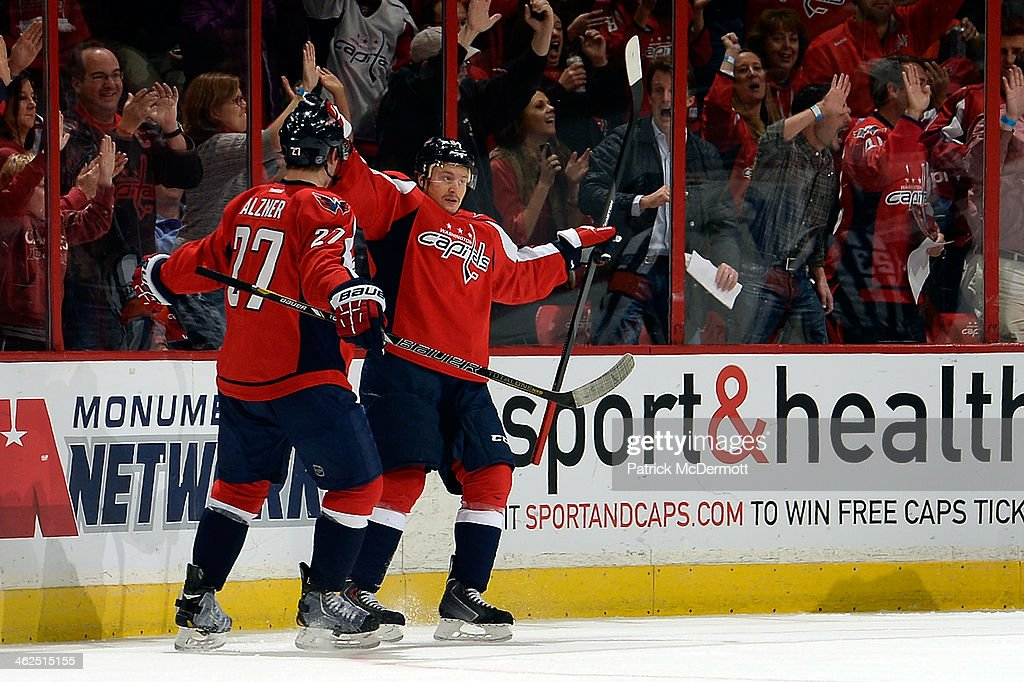 Mikhail Grabovski #84 of the Washington Capitals celebrates after scoring a goal in the first period of an NHL game against the St. Louis Blues at Verizon Center on November 17, 2013 in Washington, DC.