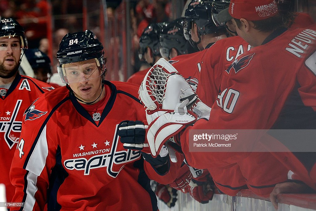 Mikhail Grabovski #84 of the Washington Capitals celebrates with his teammates after scoring a goal in the third period during an NHL game against the Columbus Blue Jackets at Verizon Center on November 12, 2013 in Washington, DC.