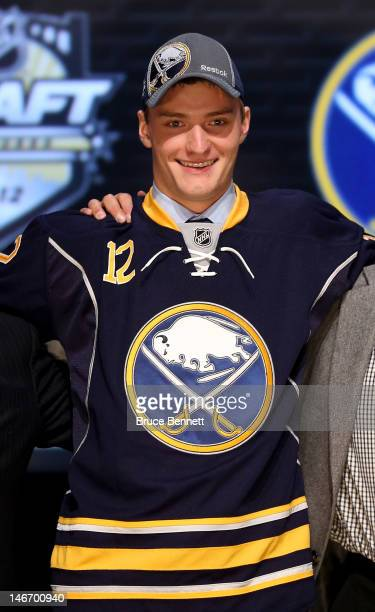 Mikhail Grigorenko, 12th overall pick by the Buffalo Sabres, poses on stage during Round One of the 2012 NHL Entry Draft at Consol Energy Center on...