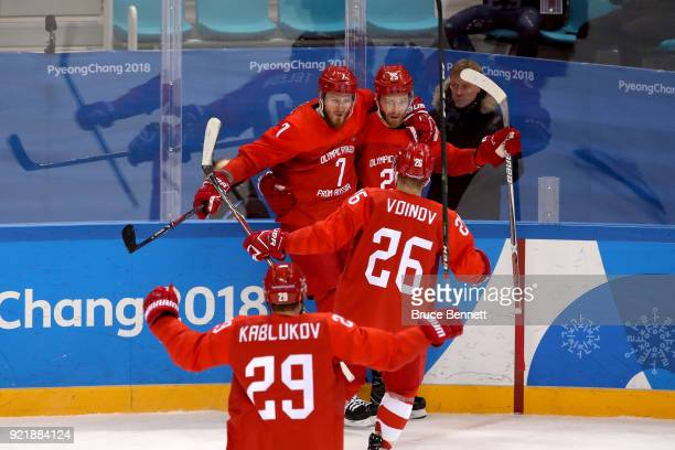 Mikhail Grigorenko of Olympic Athlete from Russia celebrates with his teammates after scoring a goal on Lars Haugen of Norway in the first period...