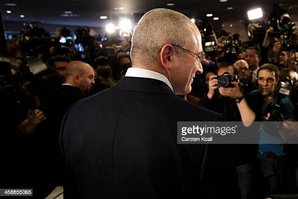 Mikhail Khodorkovsky the former Yukos oil company chairman who was charged with embezzlement and tax evasion arrives at his first press conference...
