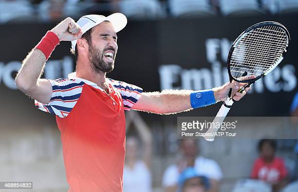 Mikhail Kukushkin of Kazakhstan celebrates after defeating Argentine Juan Martin del Potro in the quarterfinals of the Apia International Sydney at...