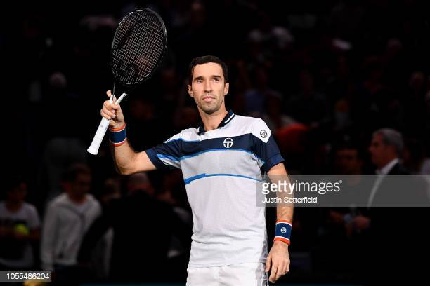 Mikhail Kukushkin of Kazakhstan celebrates winning match point in his first round match against Pierre-Hugues Herbert of France during Day 2 of the...