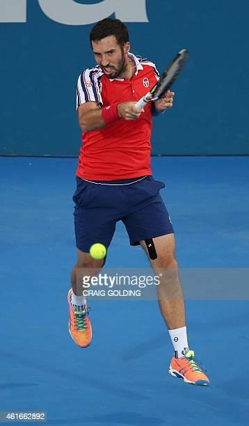 Mikhail Kukushkin of Kazakhstan plays a forehand against Viktor Troicki of Serbia in the men's singles final on day seven of the Sydney International...
